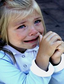 crying little blond girl