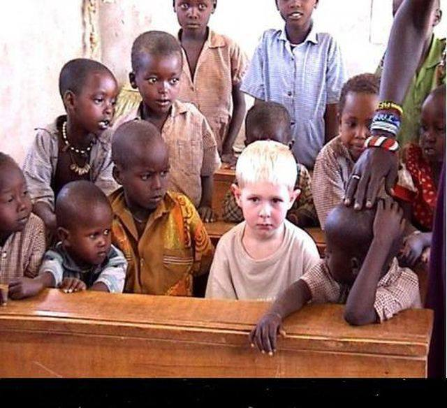little-black-boys-crowd-around-little-blond-nordic-boy