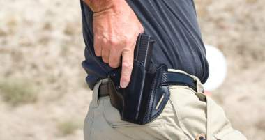 withdrawing-gun-pistol-holster