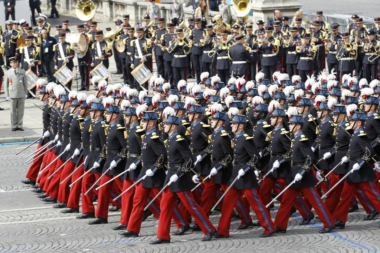 PARIS, FRANCE - JULY 14: Students of the French Special Military school of Saint Cyr march down the Champs-Elysees avenue during the annual Bastille Day military, on July 14, 2014, in Paris, France. France has issued an unprecedented invitation to all 72 countries involved in World War I to take part in its annual Bastille Day military parade. (Photo by Chesnot/Getty Images)