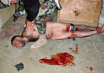 Abu-Ghraib-torture-blood-prisoner-floor