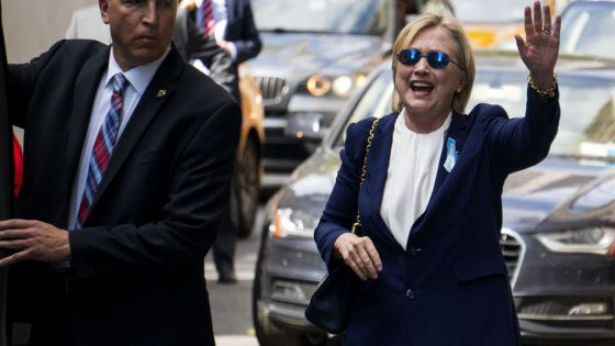 hillary-imposter-waving-equal-finger-length-1