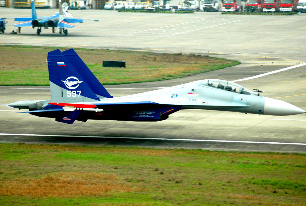 Sukhoi_Su-30LL__flying_along_runway_Zhangjiajie_Hehua_Airport_1_metre_off_ground