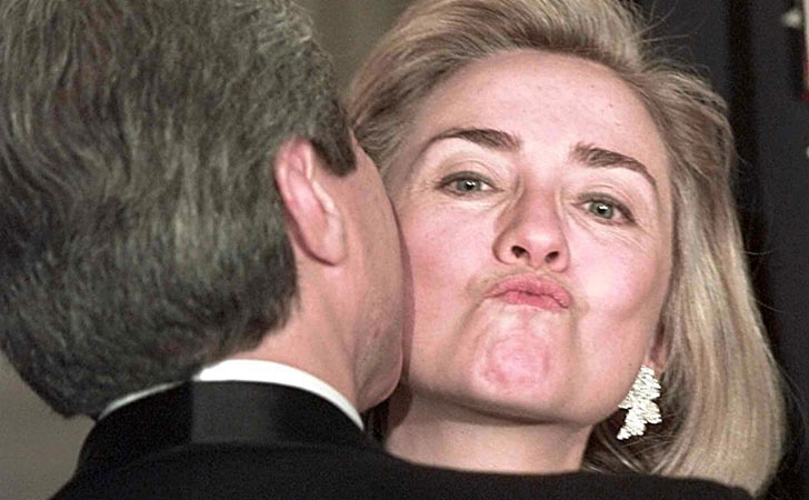 bill-smooches-hillary-grimaces