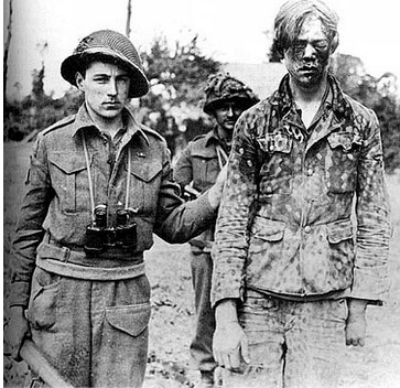 brit-soldier-1945-badly-face-beaten-german-prisoner