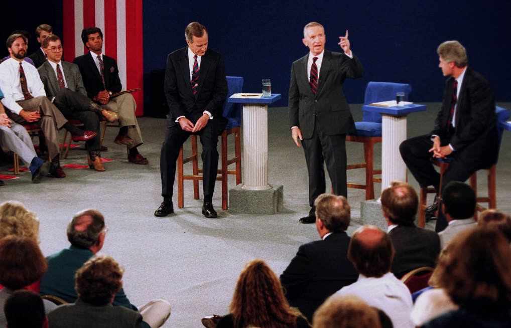 Independent candidate Ross Perot, center, answers a question during the second presidential debate at the University of Richmond, Va., Oct. 15, 1992. Republican candidate President George Bush, left, and Democratic candidate Bill Clinton listen. (AP Photo/Doug Mills)
