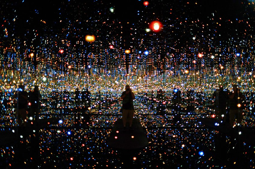 "The Japanese artist Yayoi Kusama's ""Infinity Mirrored Room - The Souls of Millions of Light Years Away"" is on display at The Broad, a pop-art styled museum, on its first day open to the public Sunday, Sept. 20, 2015 in downtown Los Angeles. The $140 million project featuring 50,000 square feet of exhibition space is the most recent accomplishment in Eli Broad's ongoing effort to remake a once seedy section of downtown Los Angeles into the cultural arts center he has long envisioned. (AP Photo/Richard Vogel)"