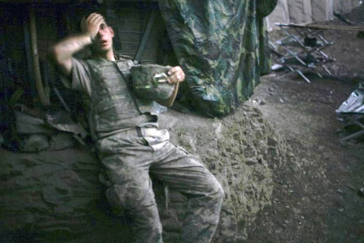 Tim Hetherington, a Vanity Fair photographer based in Britain, won the World Press Photo of the Year 2007 award with this picture of an American soldier resting at a bunker in Korengal Valley, Afghanistan