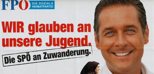 A woman in head scarf passes a billboard depicting Strache, top candidate of the Austrian Freedom Party, in Vienna