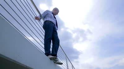 man-on-edge-of-bridge-with-suicide-thoughts-of-jumping