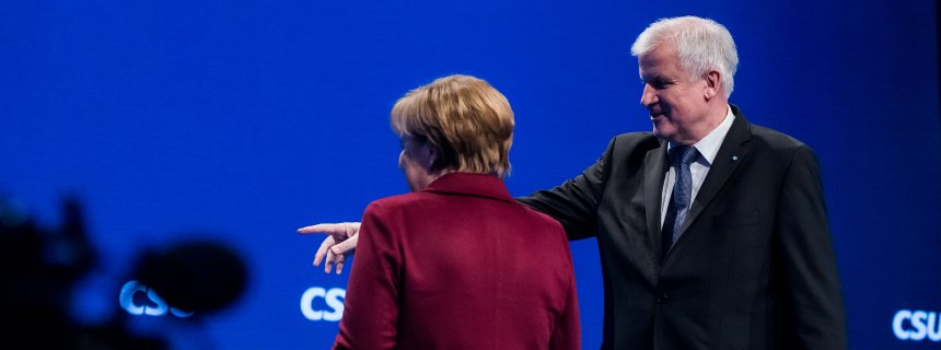MUNICH, GERMANY - NOVEMBER 20:  German Chancellor and Chairwoman of the German Christian Democrats (CDU) Angela Merkel and Bavarian Governor and Chairman of the Bavarian Christian Democrats (CSU) Horst Seehofer leave stage during the annual CSU party congress on November 20, 2015 in Munich, Germany. Members of the CSU, particularly Seehofer, have been critical of Merkel's liberal policy towards allowing so many migrants and refugees to enter Germany this year. The CDU and CSU are sister parties and together form the leading entity of the governing German government coalition. Germany is expected to receive over one million migrants and refugees this year, the vast majority of whom will apply for asylum.  (Photo by Joerg Koch/Getty Images)