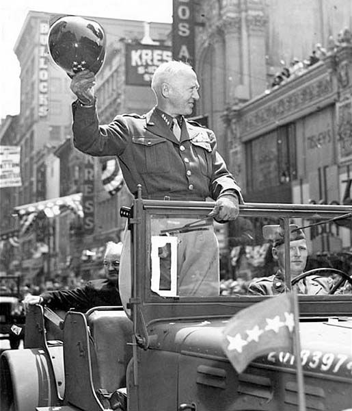 June 9, 1945: Gen. George S. Patton Jr., tips his helmet to crowd during welcome home parade on Broadway in Los Angeles. This photo was published in the June 10, 1945 LA Times.
