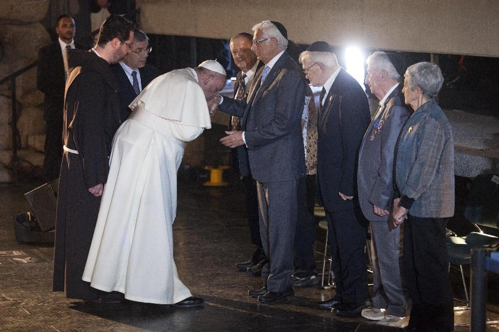 Pope Francis kisses the hand of holocaust survivors Joseph Gottdenker during a ceremony at the Hall of Remembrance in the Yad Vashem Holocaust memorial in Jerusalem, Monday, May 26, 2014. Francis honored Jews killed in the Holocaust and in terrorist attacks, and kissed the hands of Holocaust survivors as he capped his three-day Mideast trip with poignant stops Monday at some of the holiest and most haunting sites for Jews. (AP Photo/Dan Balilty)