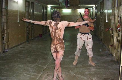 prisoner-blood-and-mud-arms-poutstretched-abu-ghraib