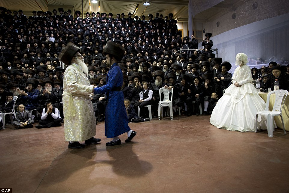 rabbi-dances-bridegroom-bride-veiled