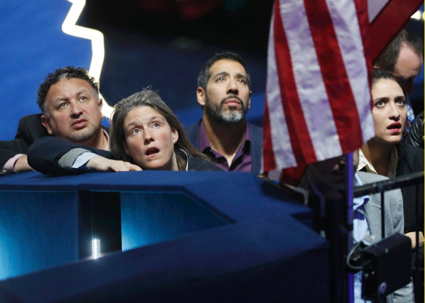 Supporters of Democratic U.S. presidential nominee Hillary Clinton watch results at the election night rally in New York, U.S., November 8, 2016. REUTERS/Rick Wilking