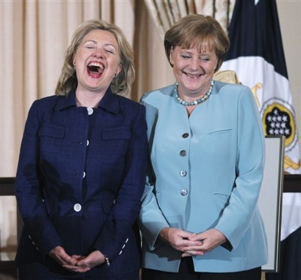 Secretary of State Hillary Rodham Clinton and German Chancellor Angela Merkel laugh during a State Luncheon in honor of the German chancellor, Tuesday, June 7, 2011, at the State Department in Washington. (AP Photo/Manuel Balce Ceneta)