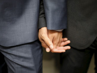 two-men-holding-hands-homo