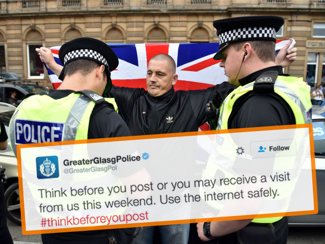uk-police-hand-up-protester-union-jack